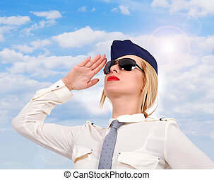 Flight attendant looking up on sky background