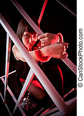 Sexy woman in fasten handcuffs to metal cage - Closeup shot...