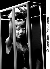 Portrait of sexy woman wearing handcuffs in cage