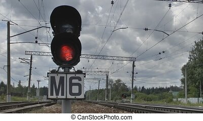 Traffic light on the railroad - Camcorder moves near the...