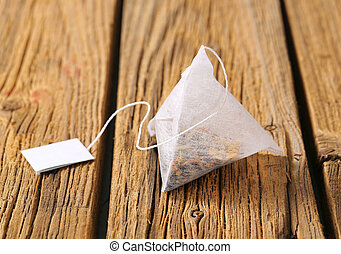 Pyramid tea bag - Pyramid-shaped tea bag on wood