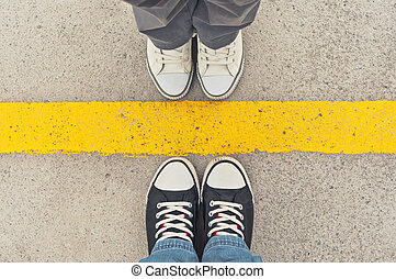 Sneakers from above. Male and female feet in sneakers from...