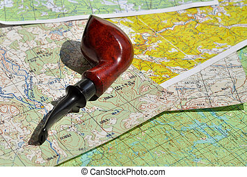 Map and Smoking pipe. The indispensable accessories for...