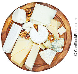 top view of wooden plate with various cheeses