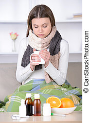 Medicine - Drinking hot tea Young woman in scurf drinking...