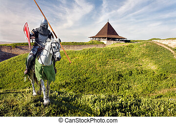 Armored knight on warhorse over old medieval castle fortress...