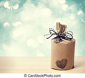 Present wraped in a rustic earthy style - Present wrapped in...