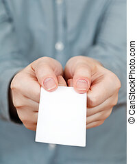 blank business card in female hands close up