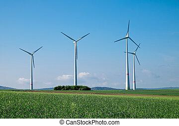 Windwheels under a blue sky, seen in rural Germany