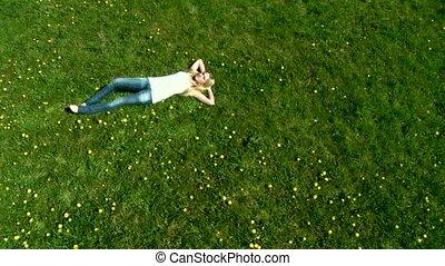 Sexy Woman - Craneshot - Sexy Woman lying on grass -...