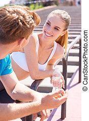 Sporty couple Young couple in sports clothing standing face...