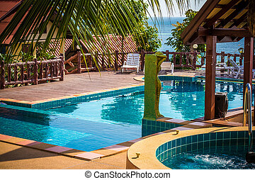 tropical resort swimming pool overlooking sea Koh phangan...
