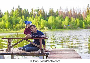 Young father and little girl fishing outdoor - Young father...