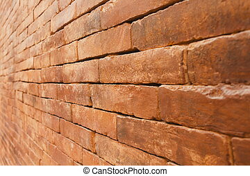 Old brick wall with diminishing perspective