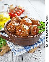 Meatballs in tomato sauce in the pot