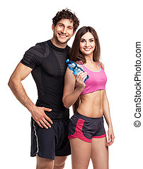Athletic man and woman with bottle of water on the white...