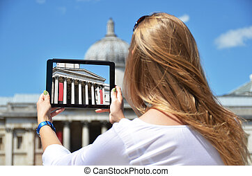 The National Gallery on the screen of a tablet. Trafalgar...