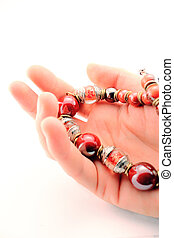 Hand with a necklace - Gesture of giving a necklace Man hand...
