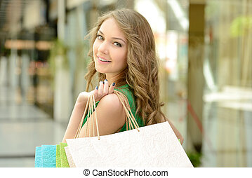 Shopping - Woman shopping Beautiful young woman shopping in...