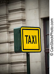 Taxi sign during the daylight hours