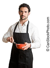 Male Cooker With Apron Smiling - Male cooker with a black...