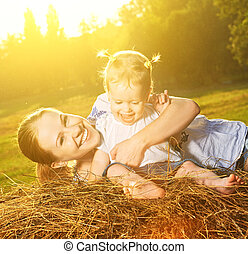 happy family in summer nature. Mother and baby daughter on...