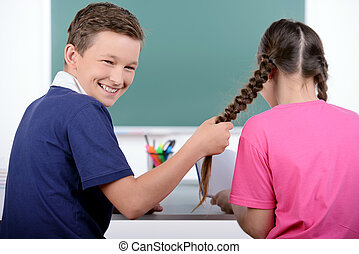 School Children - Studying together. Rear view of two little...