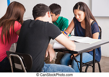 Teenagers studying at school - Group of high school students...