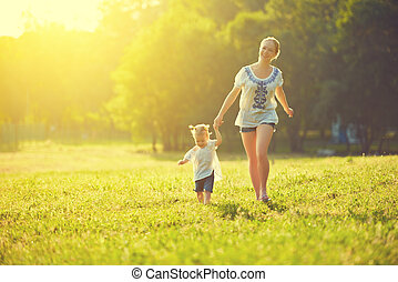 happy family on nature walks in the summer mother and child...