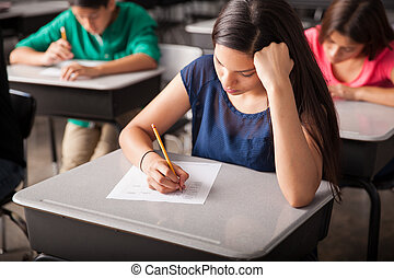 Taking a test in high school - Group of high school students...