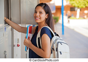 Happy high school girl - Cute Hispanic girl carrying some...
