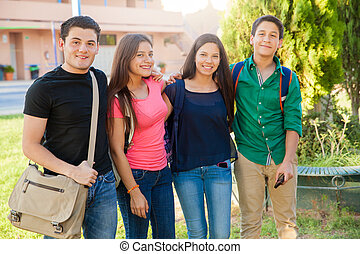 Happy teenagers at school - Portrait of a group of high...
