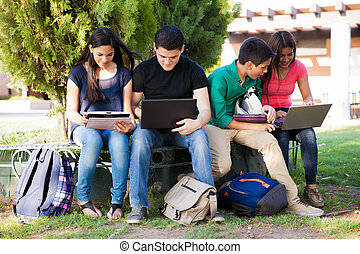 Using technology at school - Group of teenagers social...