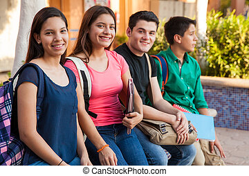 Hanging out at school - Groupo of four teenage friends...