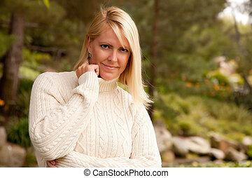 Attractive Blonde Woman in the Park