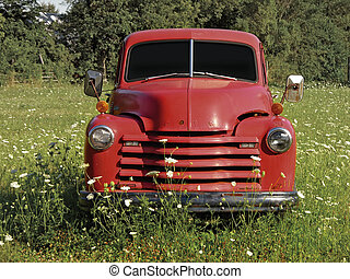 Old Truck - Old truck parked in a field. Includes a clipping...