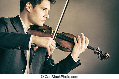 Man violinist playing violin. Classical music art - Art and...