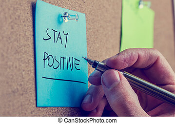 Stay positive - Retro instagram style image of a male hand...