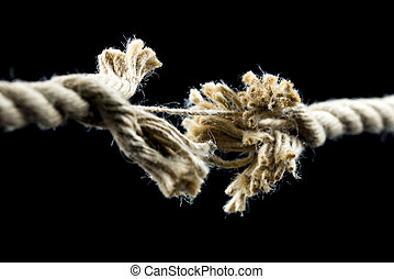 Frayed rope about to break - Closeup of frayed rope about to...