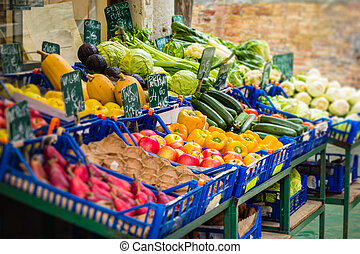 Greengrocer - a street market stall with groceries and...