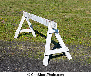 Saw horse or barrier to control traffic - A saw horse or...