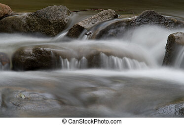 water over rocks in the stream - beautiful soft water over...