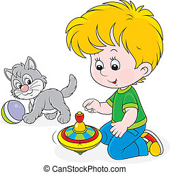 Boy plays with a whirligig and kitt - Little boy playing...