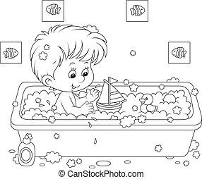 Boy bathing - Little boy playing with toys in a bath with...
