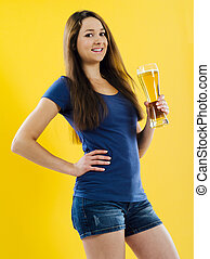 Happy young woman drinking beer
