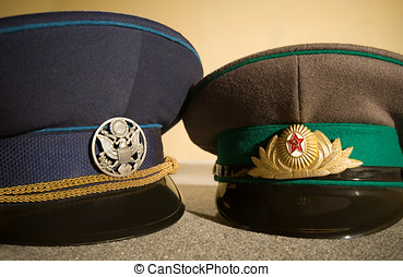 Russian and American Military Caps with Army Cockades
