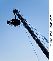 TV Camera in crane - TV Camera in a crane on a blue sky