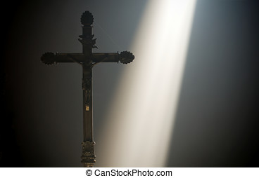 Christian cross with a ray of divine light