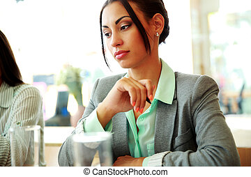 Portrait of a thoughtful businesswoman looking away in...