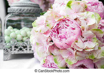 Wedding decoration - Bridal bouquet of peonies on bride and...